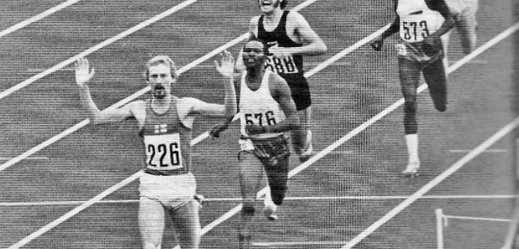 Finland's Pekka Vasala wins the 1972 Olympic 1500m final,arms raised in triumph winning a gold medal. A short stride behind Vasala, Kipchoge Keino, looks angry and disappointed in second place, Rod Dixon is shouting excitedly
